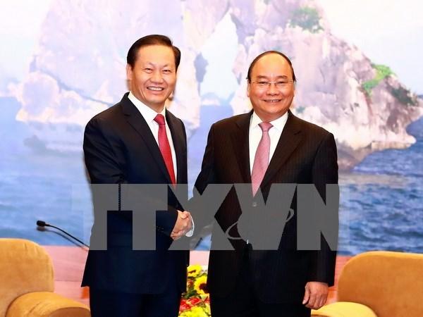 Premier vietnamita recibe a lider de region autonoma china de Zhuang hinh anh 1