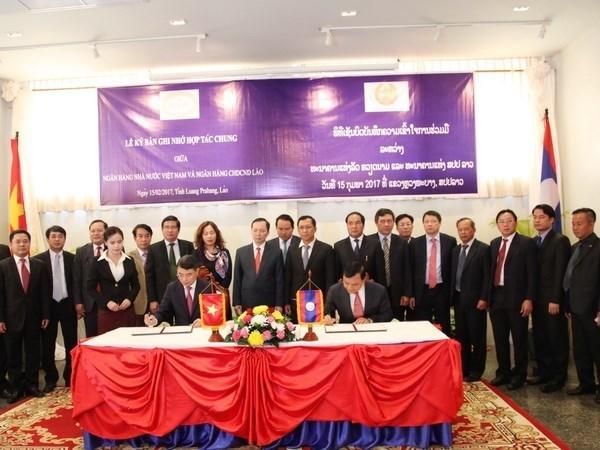 Vietnam y Laos impulsan cooperacion bancaria hinh anh 1