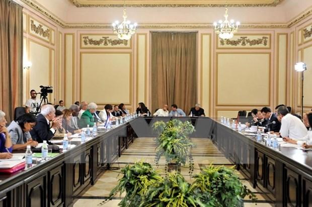 Vietnam y Cuba intercambian experiencias legislativas en seminario tematico hinh anh 1