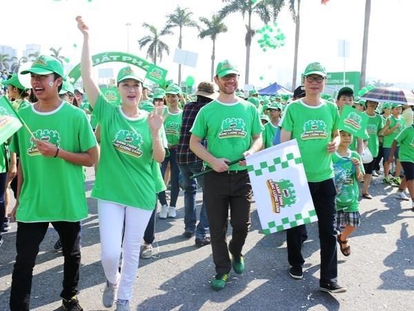 Realizan caminata en Hanoi en saludo a la Hora del Planeta hinh anh 1
