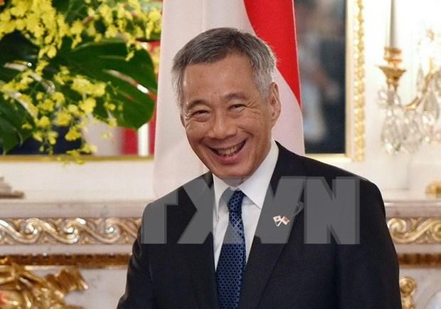 Inicia premier singapurense visita oficial a Vietnam hinh anh 1