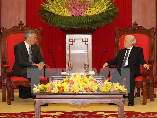 Proponen fortalecer cooperacion partidista Vietnam-Singapur hinh anh 1