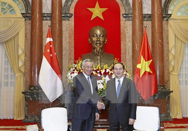 Presidente de Vietnam recibe al primer ministro singapurense Lee Hsien Loong hinh anh 1