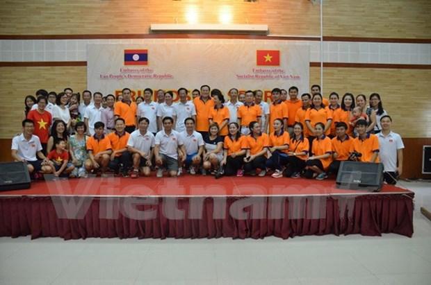 Vietnamitas y laosianos en Camboya fortalecen relaciones tradicionales especiales hinh anh 1