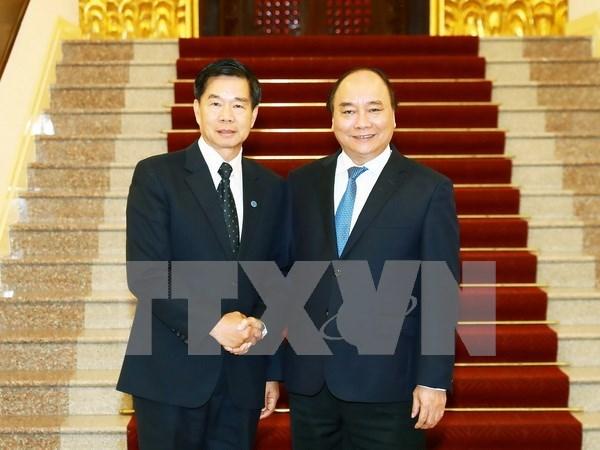 Premier de Vietnam aboga por estrechar la cooperacion entre Hanoi y Vientiane hinh anh 1