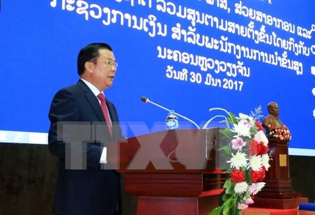 Premier de Laos destaca cooperacion financiera con Vietnam hinh anh 1
