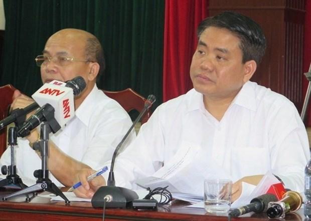 Presidente del Comite Popular de Hanoi dialoga con pobladores de Dong Tam hinh anh 1