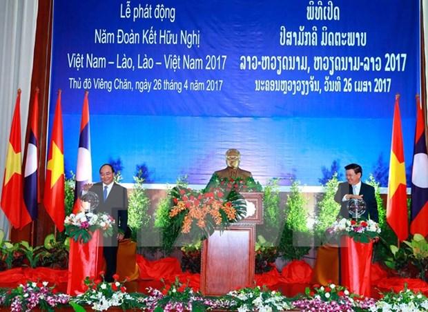 Lanzan Ano de solidaridad y amistad Vietnam- Laos hinh anh 1