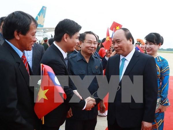 Premier de Vietnam efectua visita oficial a Laos hinh anh 1