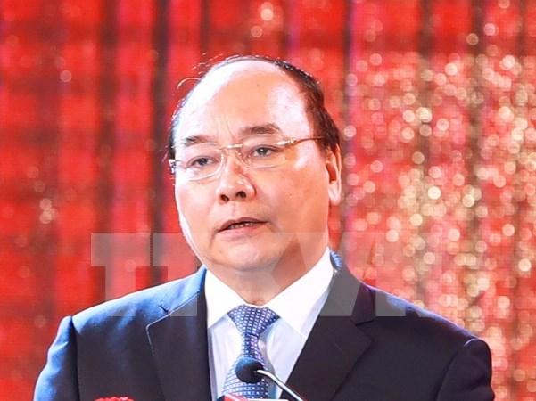 Premier vietnamita reitera favorecer actividades de empresas nacionales en Laos hinh anh 1