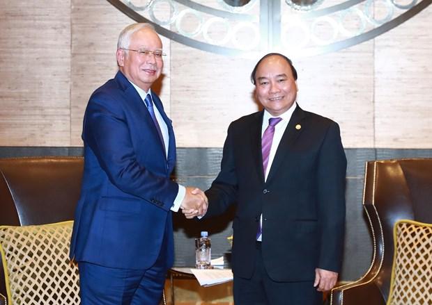 Premieres de Vietnam y Malasia intercambian temas de interes comun hinh anh 1