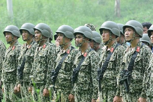 Fuerzas de seguridad de Vietnam y Laos impulsan cooperacion hinh anh 1