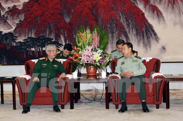 Altos funcionarios militares de Vietnam y China se reunen en Beijing hinh anh 1
