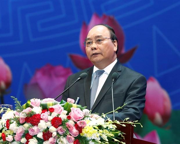 Primer ministro de Vietnam dialoga con la comunidad empresarial hinh anh 1