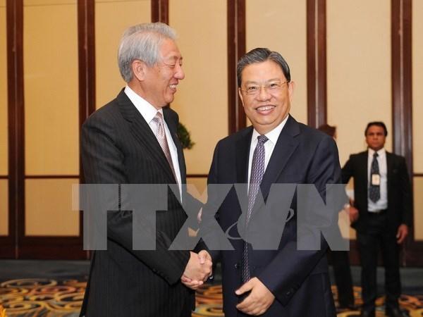 Singapur se compromete a impulsar nexos ASEAN-China hinh anh 1