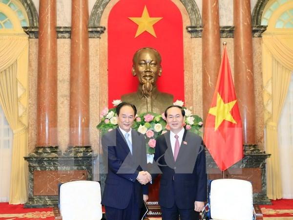 Presidente vietnamita insta a mayores nexos entre VNA y Xinhua hinh anh 1