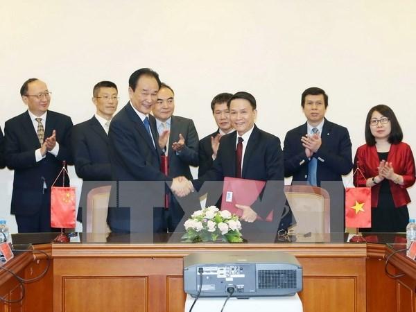 Firman VNA y Xinhua nuevo acuerdo de cooperacion hinh anh 1