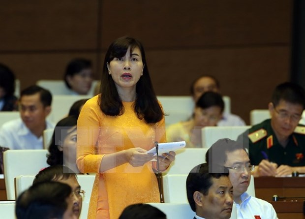 Diputados vietnamitas continuan debates sobre proyectos legales hinh anh 1