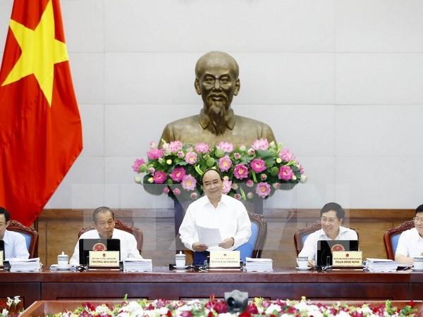 Gobierno de Vietnam evalua la marcha de economia nacional hinh anh 1