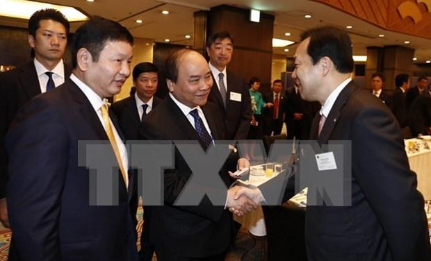 Premier de Vietnam se reune con ejecutivos de empresas japonesas de tecnologia informatica hinh anh 1