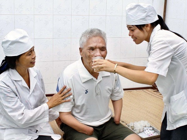 Vietnam lanza programa de apoyo a familias de martires hinh anh 1