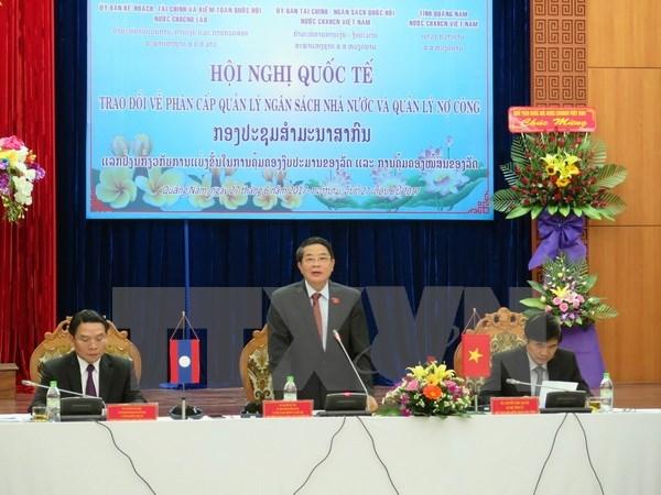 Vietnam y Laos intercambian experiencias en gestion de presupuesto estatal hinh anh 1