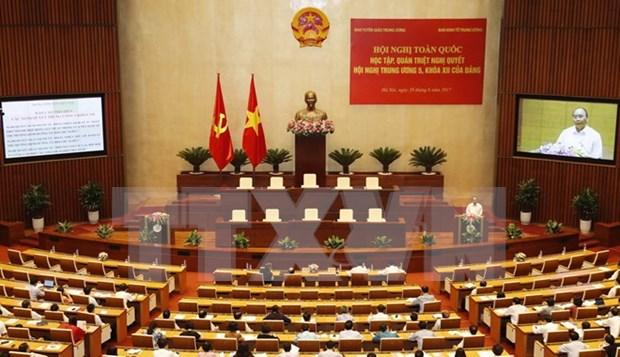 Premier vietnamita pide determinacion y accion para materializar resoluciones partidistas hinh anh 1