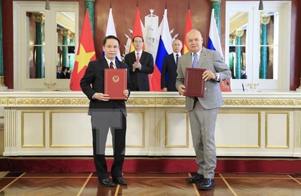 VNA y agencia de informacion rusa Sputnik fortalecen cooperacion hinh anh 1
