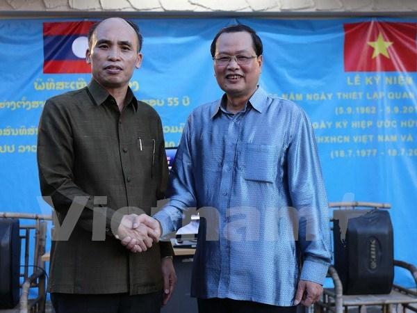 Embajadas de Vietnam y Laos en Singapur celebran encuentro de amistad hinh anh 1
