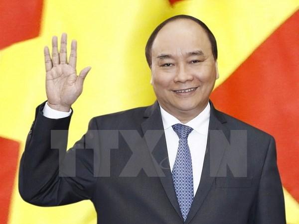 Premier vietnamita parte rumbo a Alemania para participar en Cumbre del G20 hinh anh 1