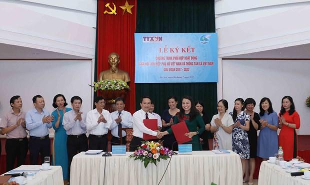 VNA y Union de Mujeres de Vietnam firman acuerdo de cooperacion hinh anh 1