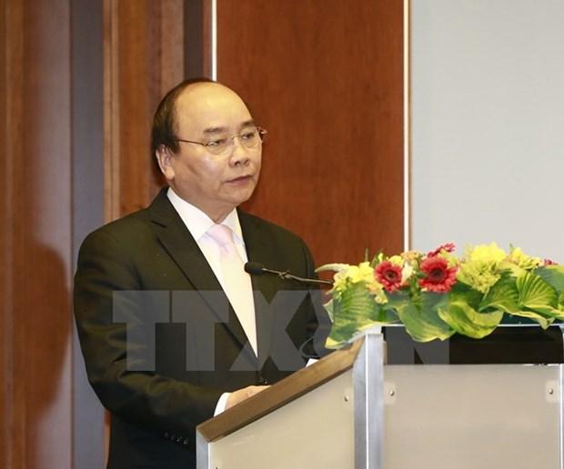 Premier Xuan Phuc llama a asistencia alemana para desarrollo sostenible de Vietnam hinh anh 1