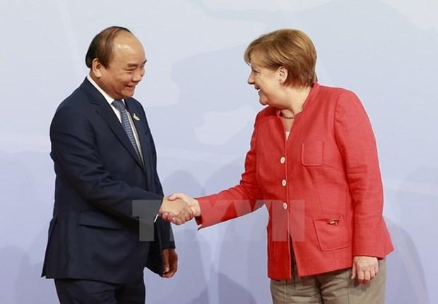 Premier de Vietnam concluye su gira por Alemania y Paises Bajos hinh anh 1