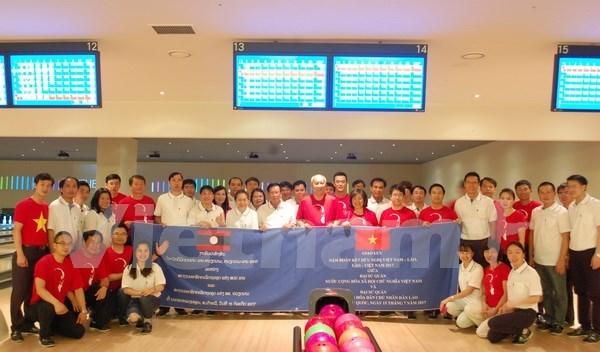 Diplomaticos vietnamitas y laosianos en Sudcorea robustecen relaciones tradicionales hinh anh 1