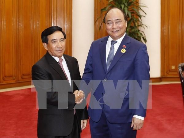 Vietnam y Laos: juntos en la construccion nacional y la integracion internacional hinh anh 1