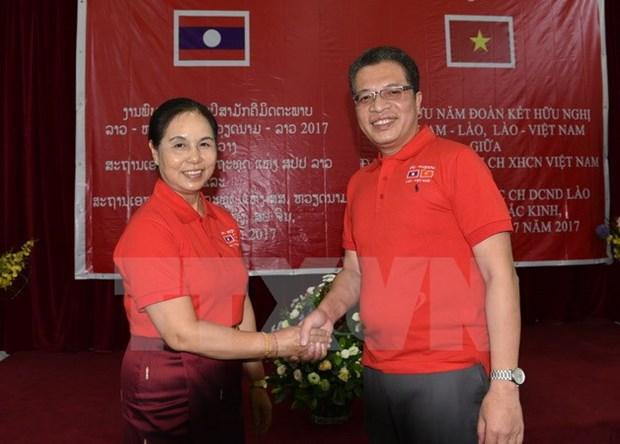 Embajadas de Vietnam y Laos en China celebran aniversario de sus lazos diplomaticos hinh anh 1