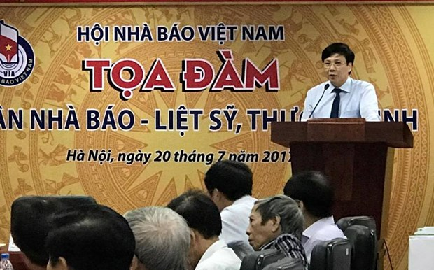 Hanoi honra a los invalidos y caidos por la patria hinh anh 1