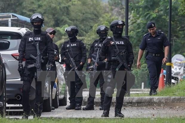 Unos 10 mil policias vigilaran las calles de Kuala Lumpur durante SEA Games 29 hinh anh 1