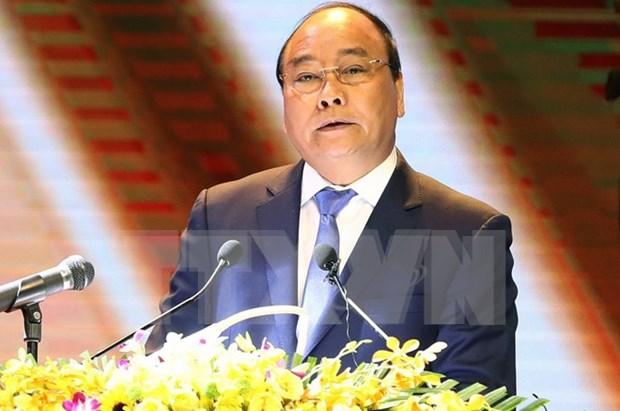 Premier Xuan Phuc exhorta a impulsar atencion a personas con meritos revolucionarios hinh anh 1