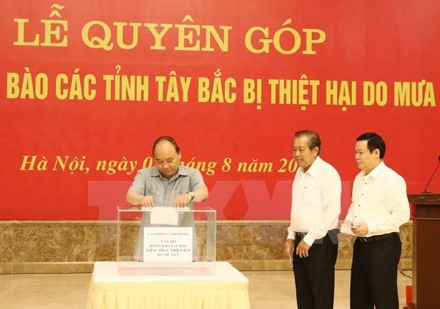 Dirigentes vietnamitas apoyan a pobladores afectados por inundaciones hinh anh 1