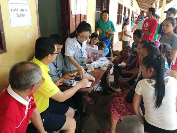Jovenes de Hanoi realizan actividades voluntarias en Laos hinh anh 1