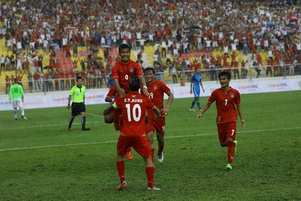 Myanmar derrota a Singapur en primer partido de futbol de SEA Games 29 hinh anh 1