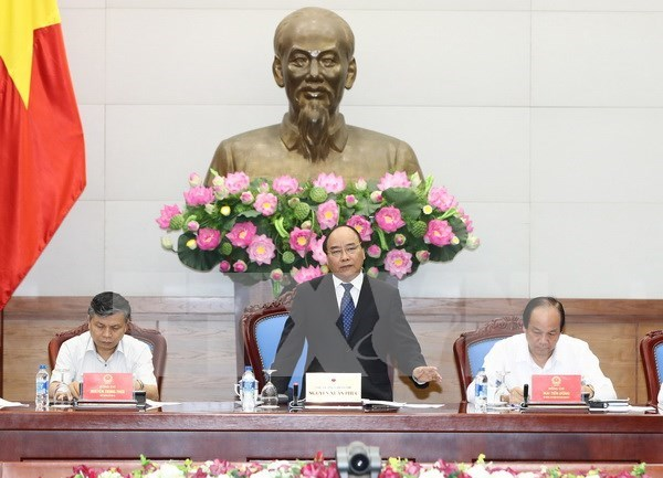 Premier insta a acelerar reforma administrativa para el desarrollo economico de Vietnam hinh anh 1