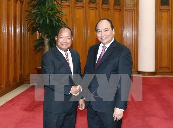 Premier vietnamita exhorta a mayor cooperacion con Laos en seguridad publica hinh anh 1