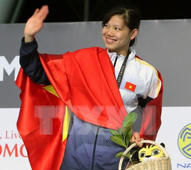 Nadadora Anh Vien cosecha mas oros para Vietnam en SEA Games 29 hinh anh 1
