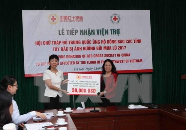 Cruz Roja de China apoya a pobladores afectados por inundaciones en Vietnam hinh anh 1