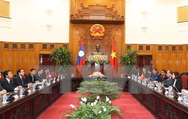 Vietnam y Laos por robustecer lazos en inspeccion partidista hinh anh 1