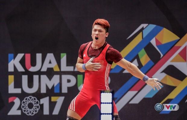 Halterofilo vietnamita bate dos records de SEA Games hinh anh 1