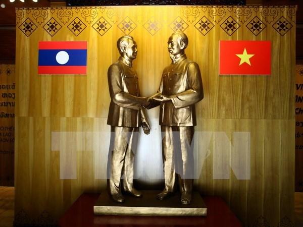 Felicitaciones por el aniversario 55 de lazos diplomaticos Vietnam-Laos hinh anh 1