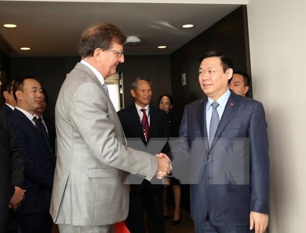 Vicepremier de Vietnam se entrevista con dirigentes de Union Europea hinh anh 1